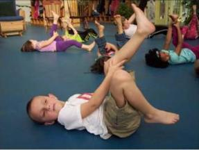 Even at their age, the kids stretch their muscles before class.